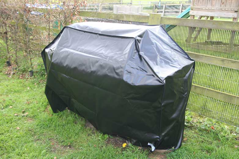 Black BBQ PVC-ST cover with shock cord pulled tight
